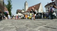 Market shoppers in background Stock Footage