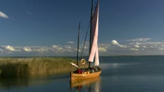 Old Sailboat on Barther Bodden on Darss Peninsula - Baltic Sea, Germany - stock footage