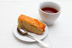 A home-made cake with a cup of tea - stock photo