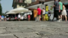 Walking on old brick road in background Stock Footage