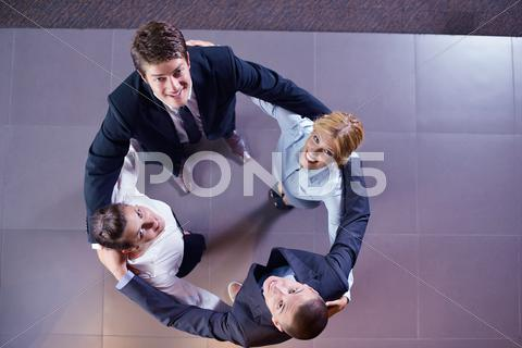 Stock photo of business people group joining hands