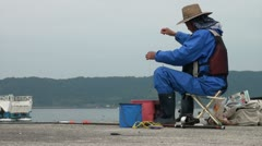 Local Japanese ferry and eldery fisherman in Japan Stock Footage