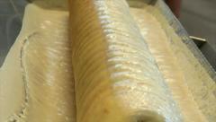 German bakery make baumkuchen cake dough comb 10781 Stock Footage