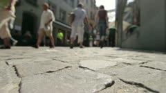 People walking down old brick road Stock Footage