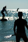 Stand up paddle shadow Stock Photos