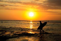 surfer sunset - stock photo