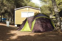 tent and bungalows in camping - stock photo