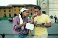 Misunderstanding between couple of tourist with map and tablet computer Stock Footage