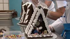 Three german confectioner build gingerbread house 10780 Stock Footage