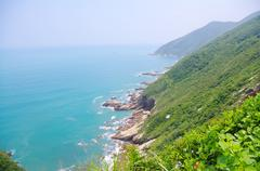 Beautiful coastline with many trees at south chinese ocean Stock Photos