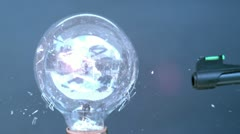 Shooting light bulb with BB gun up close Stock Footage