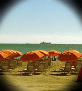 Orange Umbrellas on the Beach - stock photo
