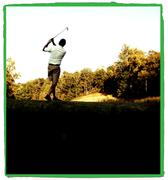 Golfer follow through Stock Photos