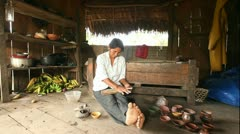 Stock Video Footage of Adult woman making pottery, rural scene in Ecuadorian Amazonia