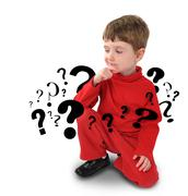 young boy with thinking about question - stock photo