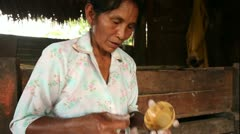 Stock Video Footage of Woman hands making pottery, rural scene in Ecuadorian Amazonia