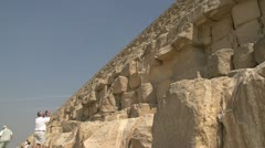History & culture,Egypt pyramids base wide shot detail with tourist taking photo Stock Footage