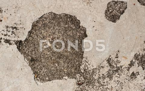 Stock photo of grunge textured concrete sidewalk with big crack