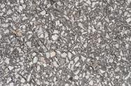 Stock Photo of old asphalt road with big grain stones.