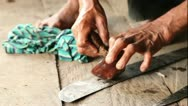 Adult woman making pottery, rural scene in Ecuadorian Amazonia, finishing Stock Footage