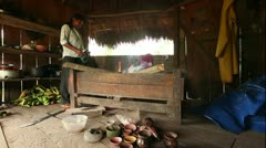 Adult woman making pottery, rural scene in Ecuadorian Amazonia Stock Footage