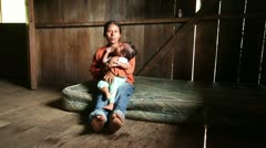 Mother with child living in very poor conditions, Ecuadorian Amazonia Stock Footage