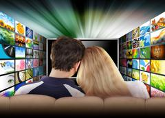 People watching television movie screen Stock Photos