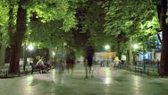 Time Lapse People Stroll Along the Boulevard at Night Stock Footage