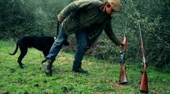 Hunter picking shotgun Stock Footage