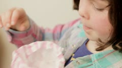 Little girl eating candy, sweets - stock footage