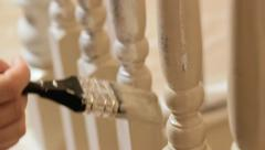 Close up painting woodwork in house, diy, home improvement - stock footage