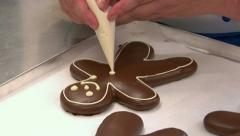 German confectioner paint face on gingerbread man 10788 Stock Footage