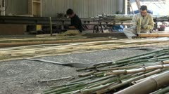 Two factory workers are splitting bamboo in Kyoto Stock Footage