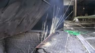 Leftover bamboo burns in an oven in a factory in Japan Stock Footage