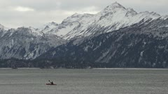 Sea Kayaker Paddling in Wintry Kachemak Bay, Alaska Stock Footage