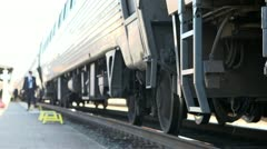 Passengers unloading from train - stock footage