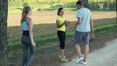 Young couple on training with personal trainer, crane shot HD Stock Footage