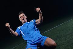 soccer players celebrating victory - stock photo