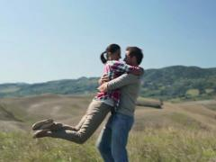 Happy young couple in love on meadow, stadicam shot NTSC Stock Footage