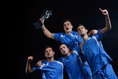 Stock Photo of soccer players celebrating victory
