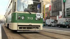 Hiroshima, Japan - a streetcar leaves the tram stop in the centre of the city Stock Footage