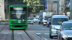 Green tram in Hiroshima and traffic Stock Footage