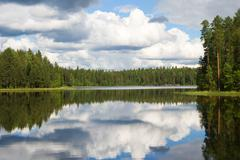 landscape of karelian lake and sky with clouds - stock photo