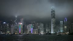 Ship, Skyscrapers, Hong Kong Island Skyline by night, Victoria Harbour, Kowloon Stock Footage