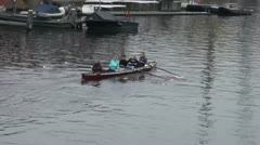 Sport boat rowing is on the canal in Amsterdam Stock Footage
