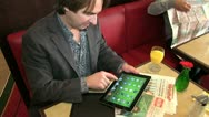 Stock Video Footage of breakfast with ipad and surfing in WLAN