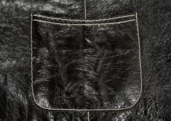 Pocket on black leather clothing - stock photo
