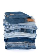 Blue denim clothes and bag Stock Photos
