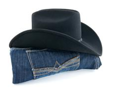 Cowboy hat and blue jeans - stock photo