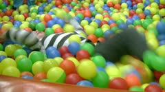 Little boy in ball pit Stock Footage